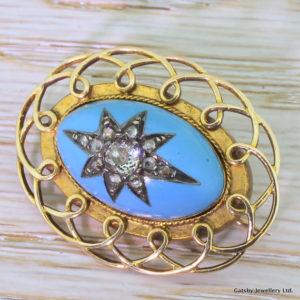 blue enamel brooch
